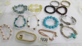 14 assorted bracelets.