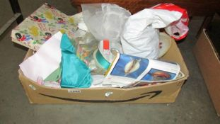 A box of haberdashery fabric pieces, ribbon, buttons, bridal head dress with veil etc.