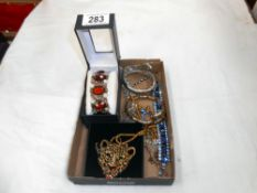 A tray of costume jewellery, bangles,