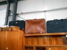 A quantity of suitcases etc.