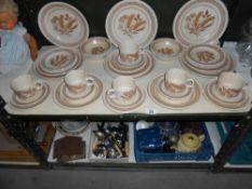A Churchill homespun stoneware dinner service approx.