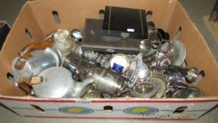A large box of mixed silver plate including coffee bean cases spoons, Piquot ware teapots etc.