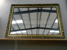 A large gilt framed bevelled edged mirror size 86cm x 61cm