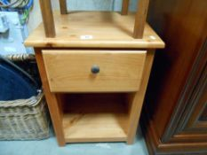 A pine bedside cabinet with a single drawer