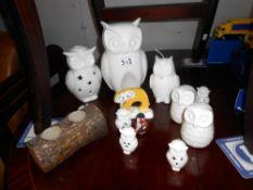 A collection of white porcelain owl ornaments, candles & salt & pepper pots etc.