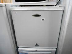 A Fridgemaster lockable counter-top fridge (uses square recessed key,