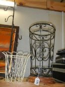 A wrought iron stick stand and 2 other items.
