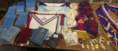 A large collection of Masonic memorabilia including various jewels, shawls, aprons,