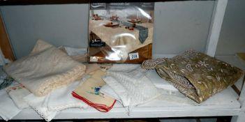 A quantity of vintage linen including tablecloths
