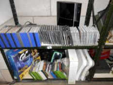2 shelves of Playstation and Nintendo and X-Box games/consoles/controls etc.