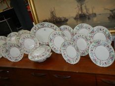 18 pieces of Royal Worcester 'Kashmir' pattern dinner ware.