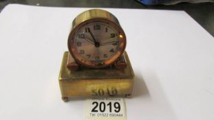 A French art deco brass alarm clock, in working order.