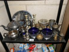 A selection of silver plated items including a teapot,