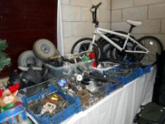 A large quantity of used bicycle parts including gears, levers, lights, seats,