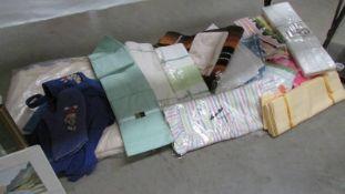 A good mixed lot of linen including bed linen.