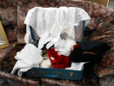A case of assorted linen in vintage suitcase
