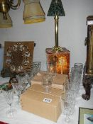 4 sets of 6 glasses and a candle lamp.