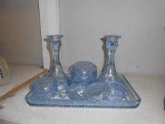 A 1930's blue glass trinket set