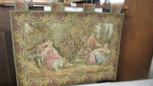 A classical design tapestry on a wooden pole.