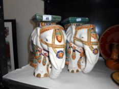 A pair of pottery elephant plant stands,
