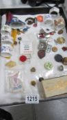 A jewellery case of assorted badges etc.