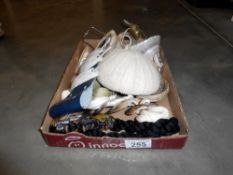 A pair of sea shell lamp shades and other sea shell items