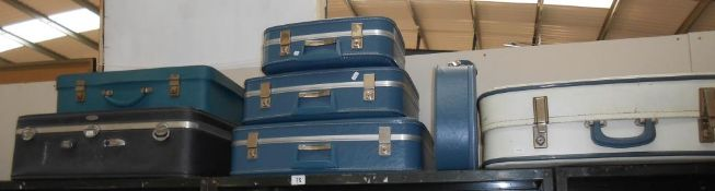 A set of 3 vintage graduated matching suitcases plus quantity of others (1 missing handle)