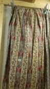 A pair of brown and white paisley pattern curtains 214 cm wide x 170 cm drop.