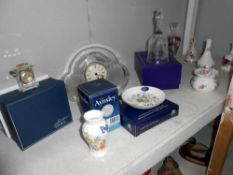 An Edinburgh crystal bell, Aynsley china, glass clock and quantity of other ornaments,