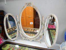 A vintage Ormolu style oval triple dressing table mirror