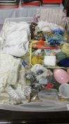 A large box of vintage textiles including fabric, trims, lace, children's clothing,