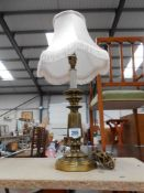 A vintage spelter table lamp with an antique brass finish,
