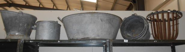 A vintage galvanised bath and quantity of buckets etc.