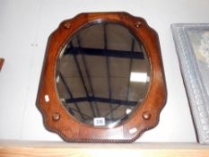 A wooden framed mirror, size 60cm x 50cm approx.