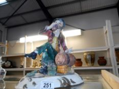 A Capo Di Monte figure of a tramp,
