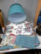Teal coloured bedding,