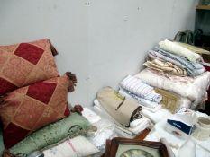 A good collection of linen, pillows etc.