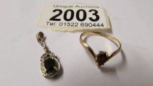 A yellow gold diamond and sapphire pendant together with a 9ct gold sapphire ring, size O,