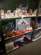 3 shelves of Christmas decorations including nativity figures and vintage items