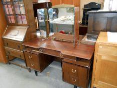 A 1970's oak dressing table 124cm x 46.