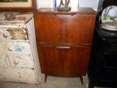 A vintage Hubbinet drinks cabinet 59.