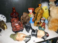 A pair of Shellcraft head wall ornaments, glazed stoneware figure bottle, buddah etc.