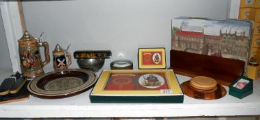 A quantity of miscellaneous items, including Clan Cameron placemats and coasters, beer steins,