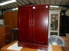 A dark wood stained 2 door cd storage cupboar+d 59.