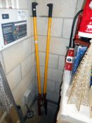 A post hole digging tool just under 5ft in height