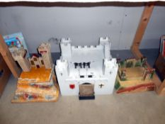 A large white vintage wooden fort with opening draw bridge and 2 others