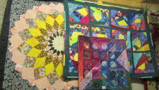 Three hand made quilts, 110 x 110 cm, 117 x 90 cm, 60 x 60 cm,
