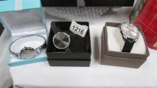 2 DMQ wrist watches and a Pilgrim wrist watch.