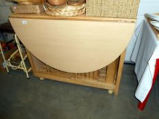 A Beech effect kitchen table with 2 drawers and 4 hidden folding chairs ****Condition