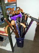 A large quantity of walking sticks etc